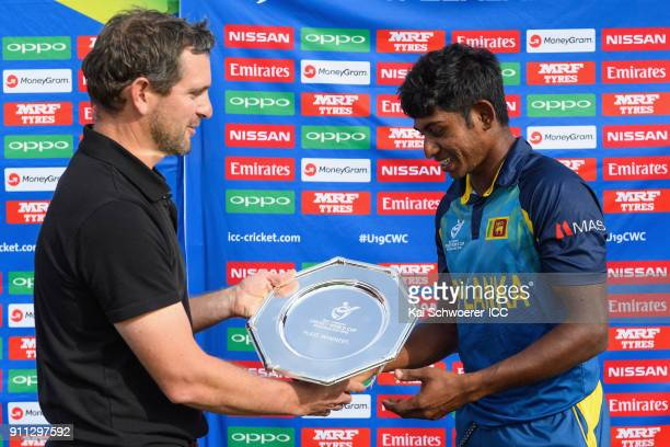 Tournament Director Brendan Bourke presents the trophy to captain Kamindu Mendis of Sri Lanka following the ICC U19 Cricket World Cup Plate Final...