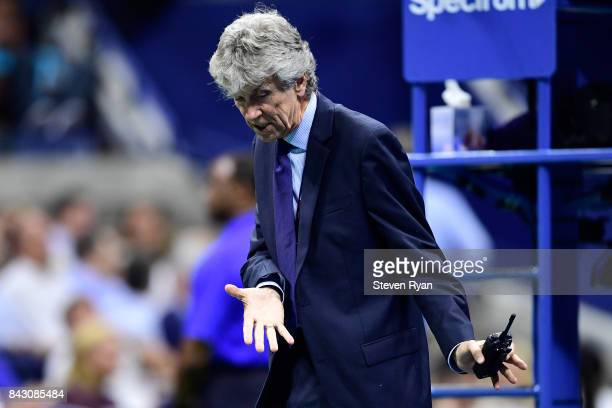 Tournament Director Brian Earley assesses the court during the Women's Singles Quarterfinal match between Venus Williams of the United States and...