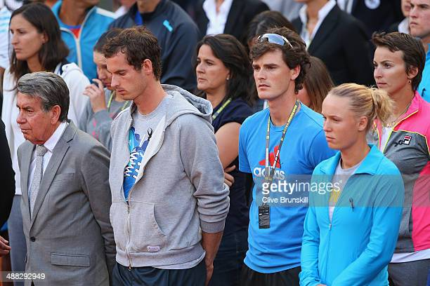 Tournament director Manolo Santana, Andy Murray and Jamie Murray of Great Britain and Caroline Wozniacki of Denmark stand for a minutes silence for...