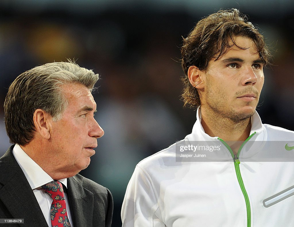 Tournament director Manolo Santana tries to talk with Rafael Nadal of Spain after losing his final match against Novak Djokovic of Serbia in straight sets during day eight of the Mutua Madrilena Madrid Open Tennis on May 8, 2011 in Madrid, Spain. Djokivic won the match in straight sets.