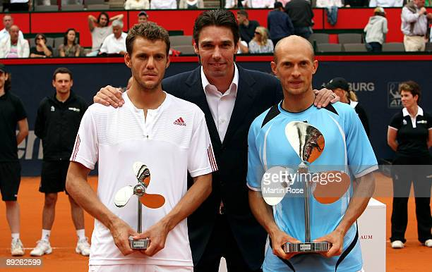 Tournament director Michael Stich poses with Nikolay Davydenko of Russia and Paul Henri Mathieu of France for a photo during day seven of the...