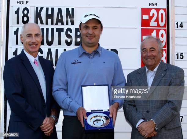 Tournament Director Mike Stewart Simon Khan of England and Angel Gallardo ViceChairman of the PGA European Tour Board of Directors pose with the...