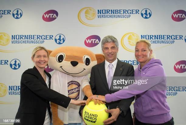 Tournament director Sandra Reichel, mascot Talentino, chairman Dr. Armin Zitzmann of the Nuernberger Versicherungsgruppe and captain of the German...