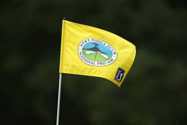 A Tournament Flag Billows In The Wind During Third Round Of At T Pebble Beach