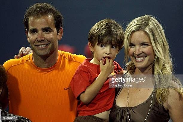 Tournament honoree Pete Sampras poses for a portrait with son Ryan and wife Bridgette Wilson during the LA Tennis Open Day 1 at Los Angeles Tennis...