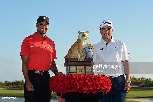 Tournament host Tiger Woods and Hideki Matsuyama of Japan poses with the winner's trophy during the Hero World Challenge at Albany course on December...