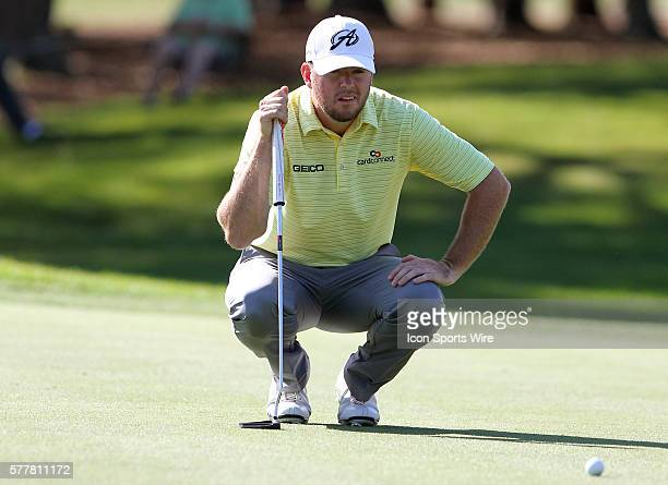 Tournament leader Robert Garrigus looks for the line of his putt during the third round of the Valspar Championship at Innisbrook Resort - Copperhead...