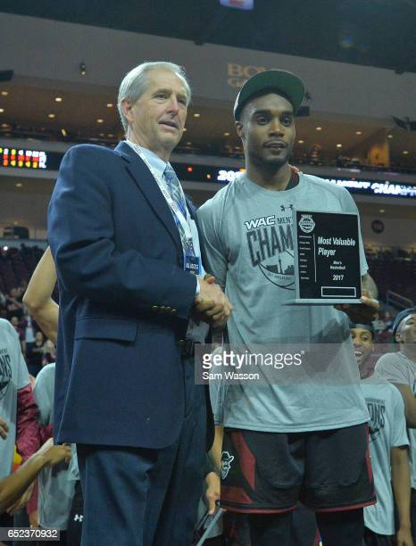 Tournament Most Valuable Player Ian Baker of the New Mexico State Aggies poses with Western Athletic Conference commisioner Jeff Hurd following the...
