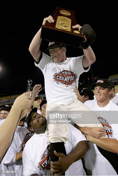 Tournament MVP Jonah Nickerson of the Oregon State Beavers is hoisted into the air by his teammates with the National Cahmpionship Trophy after they...