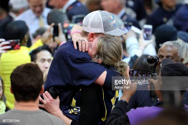 Tournament MVP Moritz Wagner of the Michigan Wolverines celebrates with his mother after defeating the Purdue Boilermakers 7566 during the...