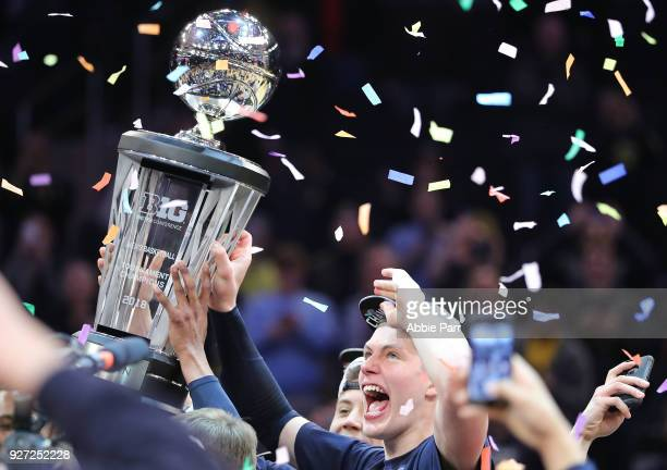 Tournament MVP Moritz Wagner of the Michigan Wolverines celebrates after defeating the Purdue Boilermakers 7566 during the championship game of the...