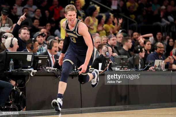 Tournament MVP Moritz Wagner of the Michigan Wolverines reacts after making a three point basket in the second half against the Purdue Boilermakers...