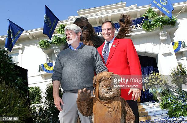 Tournament of Roses President Paul Holman with Filmmaker George Lucas and his Star Wars characters Wicket the Ewok and Chewbacca attend the unveiling...