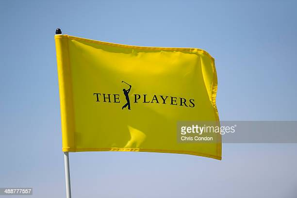 A tournament pin flag flies during the first round of THE PLAYERS Championship on THE PLAYERS Stadium Course at TPC Sawgrass on May 8 2014 in Ponte...