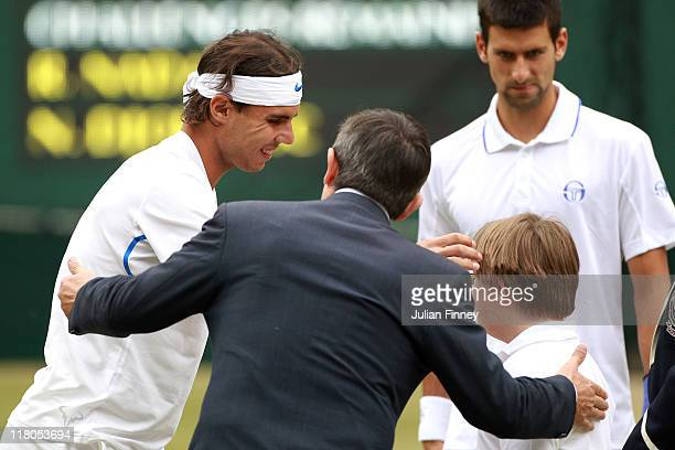 Tournament Referee Andrew Jarrett and George Griffiths perform the coin toss before the final round Gentlemen's match between Rafael Nadal of Spain...