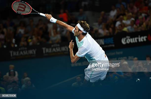 Tournament top seed Roger Federer of Switzerland serves against Tobias Kamke of Germany during their men's singles match on the fifth day of the...