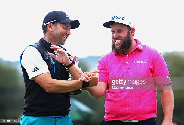 Tournament winner Andrew Johnston of England shakes hands with Sergio Garcia of Spain after victory during the final round on day four of the Open de...