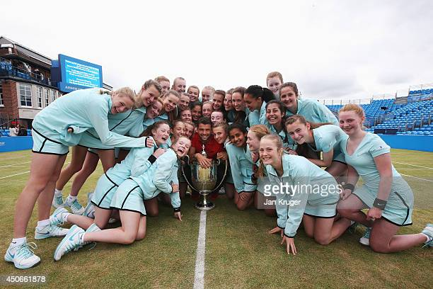 Tournament winner Grigor Dimitrov of Bulgaria poses with tournament ballgirls following his victory in the Men's Singles Final on day seven of the...