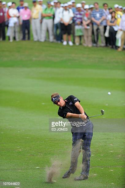 Tournament winner Ian Poulter of England hits a shot during the final day of the UBS Hong Kong Open golf tournament at the Hong Kong Golf Club on...