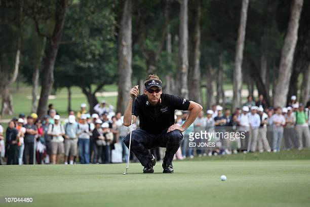 Tournament winner Ian Poulter of England lines up a putt during the final day of the Hong Kong Open golf tournament at the Hong Kong Golf Club on...