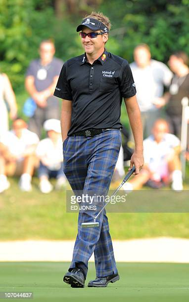 Tournament winner Ian Poulter of England smiles as he leaves the 15th green during the final day of the UBS Hong Kong Open golf tournament at the...