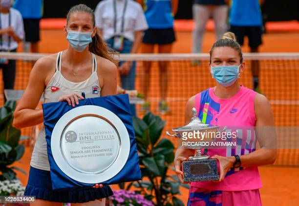 Tournament winner Romania's Simona Halep and runner-up Czech Republic's Karolina Pliskova pose with their trophy after the final of the Women's...