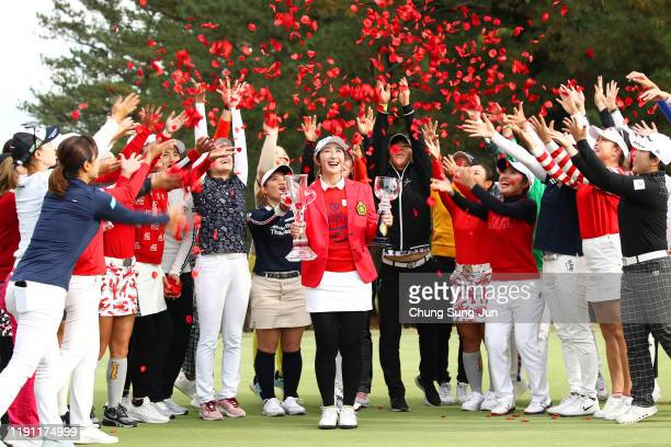 Tournament winner Seonwoo Bae of South Korea is congratulated by her fellow golfers after the award ceremony following the final round of the LPGA...