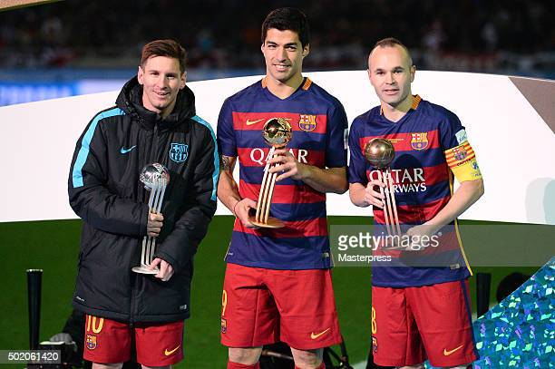Tournament Winners Lionel Messi Luis Suarez and Andres Iniesta of Barcelona with the trophies after the FIFA Club World Cup Final between River Plate...