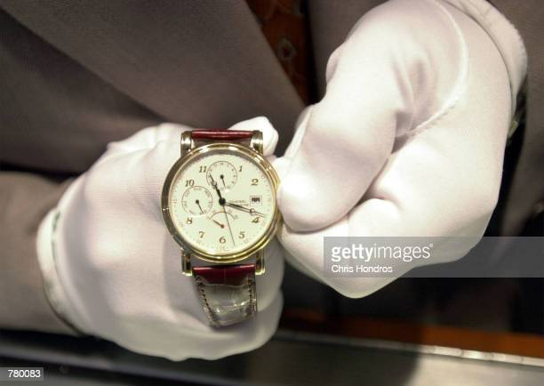 Tourneau Time Machine employee Pellegrino John Bongiovi sets one of the 20000 watches in the Manhattan watch store ahead an hour for the onset of...