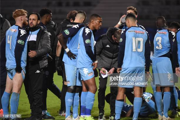 Tours' French head coach Nourredine El Ouardani talks to Tours' defender Alexis Gonzalez before the penalty shoot-out during the French Cup round of...