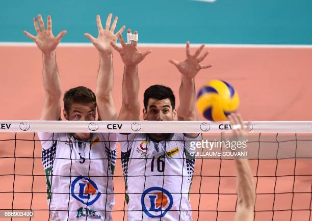 Tours Volley Ball's French middleblocker Quentin Jouffroy and Tours Volley Ball's Brasilian OutsideSpiker Levi Alves Cabral compete during the CEV...