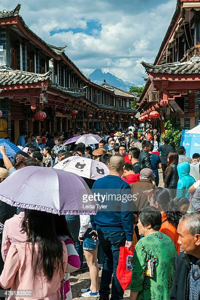 Toursist in Lijiang old town for Golden Week a national holiday and together with Chinese New Year one of the biggest human migrations of the year...