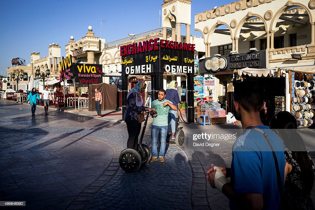 Toursists stroll and segway along the main street of Nama Bay on November 05, 2015 in Sharm El-Sheikh, Egypt. If the tourism industry in Egypt collapses, workers who rely on the tourist industry could lose their income. British flights going to and from the Egyptian resort were grounded today, as investigations continue into the crash of a Russian Airbus-321 earlier this week. This will affect around 20,000 British tourists currently in Sharm El-Sheikh according to Downing Street.
