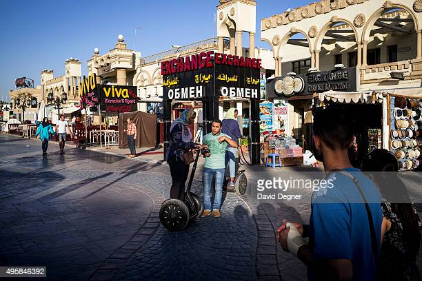 Toursists stroll and segway along the main street of Nama Bay on November 05 2015 in Sharm ElSheikh Egypt If the tourism industry in Egypt collapses...