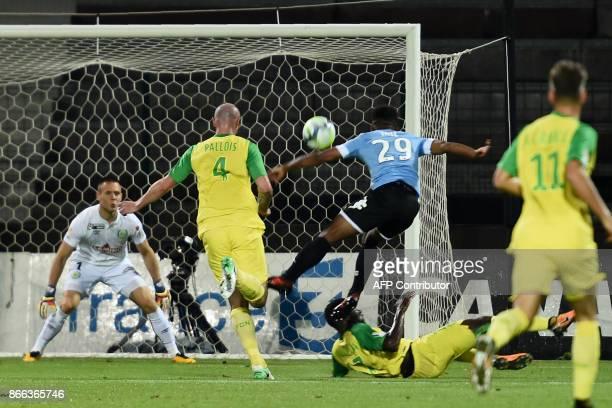 Tours's French forward Maki Tall kicks the ball between Nantes's French defender Nicolas Pallois and Nantes' French forward Wilfried Moimbe during...