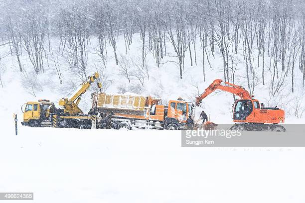 A tow car is rescuing a snowplough