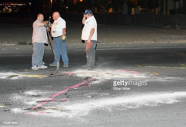 Tow company workers clean up the road where boxer Diego Corrales crashed his motorcycle and died according to a report from boxing promoter Gary Shaw...
