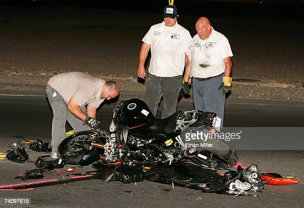 Tow company workers look over boxer Diego Corrales' motorcycle after he was involved in a fatal crash according to a report from boxing promoter Gary...