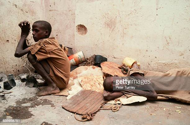 Tow gaunt Somali boys in a shelledout house during the famine The hunger crisis resulted from Somalia's civil war which began in the 1980s when...
