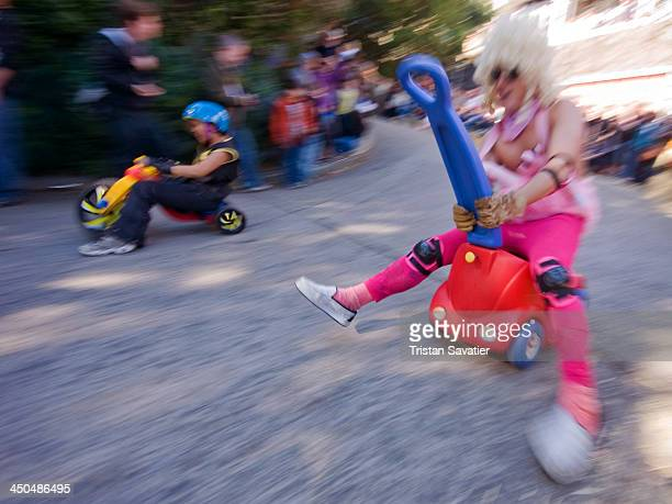 CONTENT] Tow of the contestants racing downhill at the annual 'Bring Your Own Big Wheel' race BYOBW is a free and unauthorized event People race with...