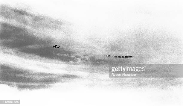 A tow plane and banner hired by NASCAR driver Tim Richmond flies over the Daytona International Speedway during the 1988 Daytona 500 on February 15...
