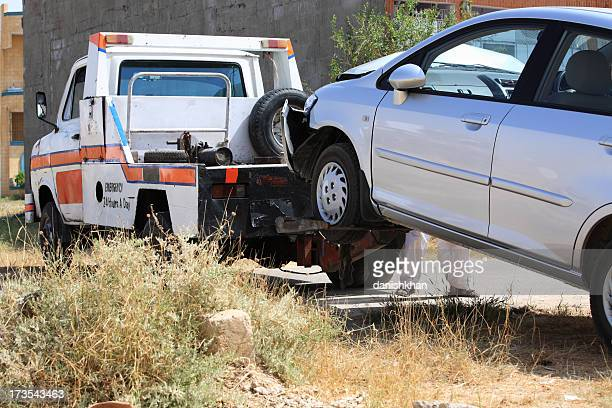 tow service - tow truck stock photos and pictures