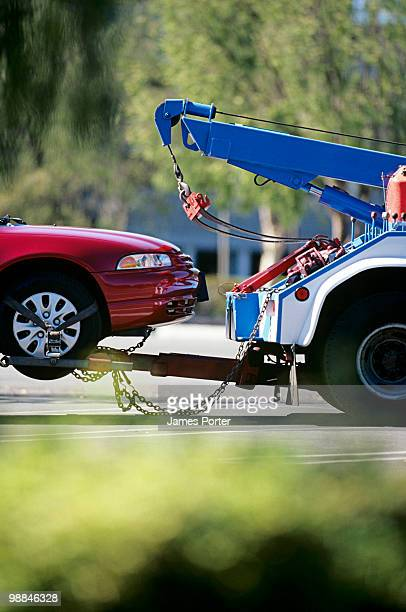 tow truck and car - tow truck stock pictures, royalty-free photos & images