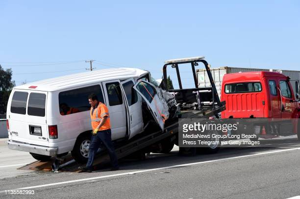 Tow truck driver loads up a van following a traffic collision on the 405 North freeway at the 605 North interchange in Seal Beach on Wednesday, March...