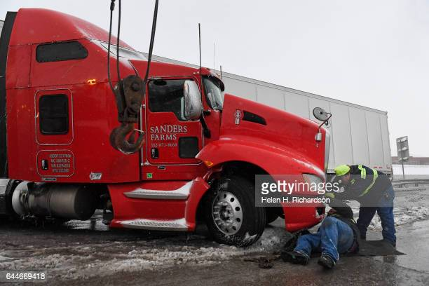 Tow truck drivers with Denver West Towing work on getting a large jackknifed semitractor trailer off of the 6th ave exit off of C470 on February 23...