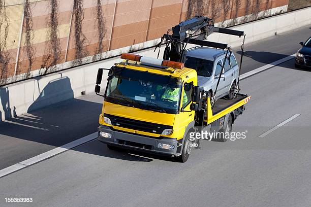 tow truck on the highway - tow truck stock pictures, royalty-free photos & images