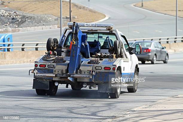 tow truck - tow truck stock photos and pictures