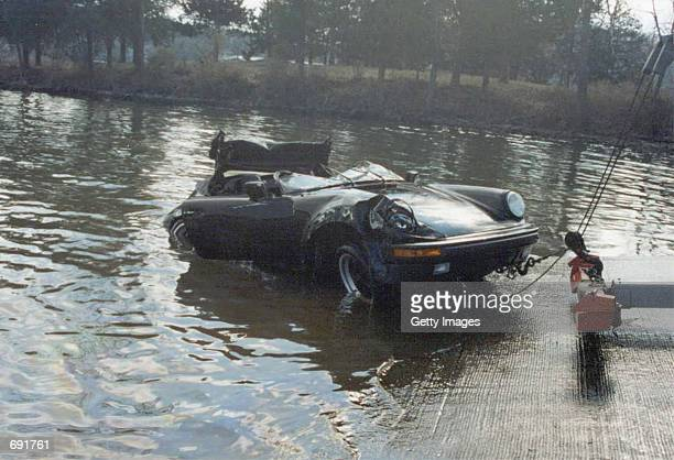 A tow truck pulls Nicolas Cages 1989 Porsche Sportster January 16 2002 from the Lake of the Ozarks MO The $100000 collectors item was in transport...