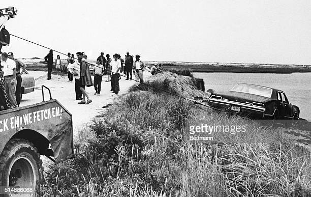 A tow truck pulls Senator Edward Kennedy's car out of Poucha Pond after the Senator's infamous accident on Chappaquiddick Island