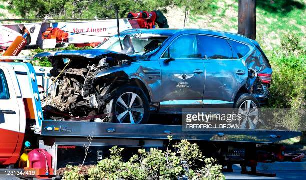 Tow truck recovers the vehicle driven by golfer Tiger Woods in Rancho Palos Verdes, California, on February 23 after a rollover accident. - Woods was...